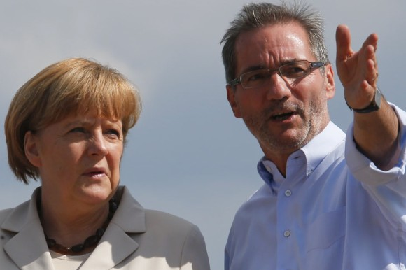 German-Chancellor-Merkel-and-Brandenburg-State-Premier-Platzeck-speak-at-the-bank-of-the-river-Elbe-in-the-town-of-Wittenberge