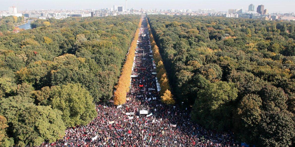angela-merkel-surprised-by-massive-protest-march-against-ttip-in-berlin